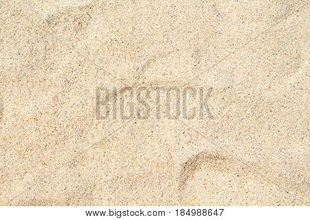 Sunny beach sand closeup for background. Tropical beach photo. Exotic island sandy beach texture. Soft sand surface backdrop for vacation template holiday card or banner. Seaside coral sand surface