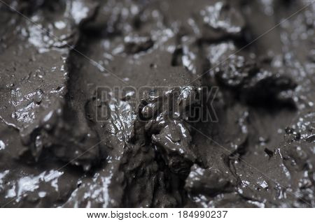 Therapeutic mud black macro photo for background
