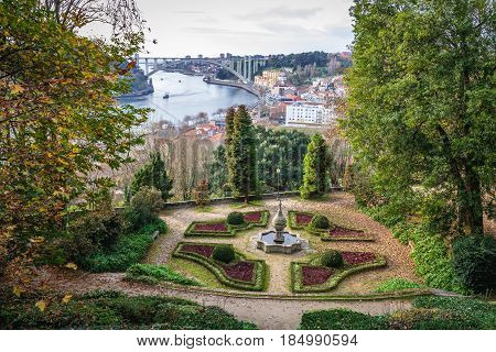 Fountain in Crystal Palace Gardens and Douro River in Porto Portugal