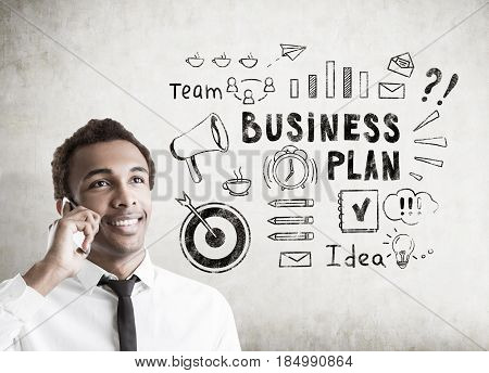African Man With Phone And Business Plan