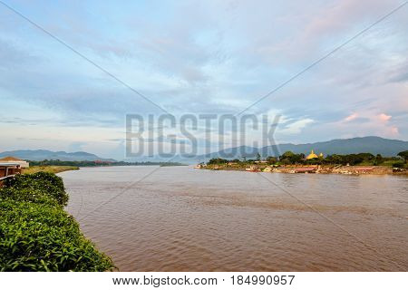 Natural landscape of Mekong River is a muddy color during sunset at Golden Triangle Park (Sob Ruak) is the border between Thailand Laos and Myanmar in Chiang Rai Province Thailand