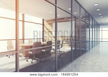 Side view of a wooden conference room interior with a long table and two rows of white office chairs by its sides. Horizontal poster. 3d rendering mock up toned image