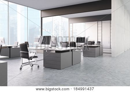 Gray open office with panoramic windows gray computer tables with desktops and black office chairs. 3d rendering.