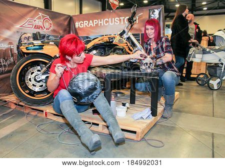 St. Petersburg Russia - 15 April, Moto artist at work,15 April, 2017. International Motor Show IMIS-2017 in Expoforurum. Visitors and participants of the annual moto-salon in St. Petersburg.