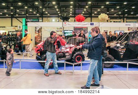 St. Petersburg Russia - 15 April, Visitors near a number of ATVs,15 April, 2017. International Motor Show IMIS-2017 in Expoforurum. Visitors and participants of the annual moto-salon in St. Petersburg.