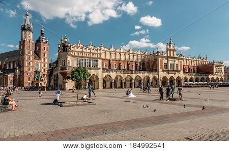 POLAND, KRAKOW- JULY 02: View over the huge european square with ancient buidlings of romanesque style in Krakow Poland on July 02, 2015
