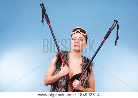 Woman Wearing Bra And Holding Ski Poles