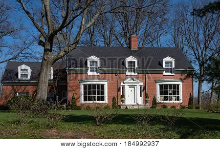 Brick Cape Cod House with Inset Dormers