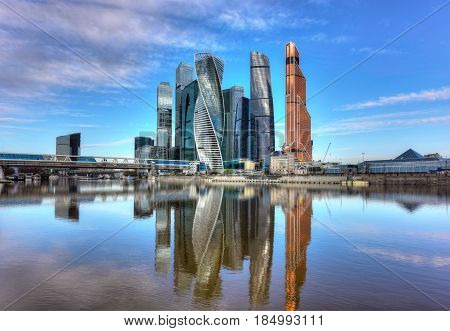 RUSSIA/ MOSCOW - MAY 1, 2017. Moscow International Business Center and pedestrian bridge Bagration on a summer morning. Moscow, Russia
