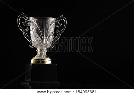 low key  of trophy in the black background