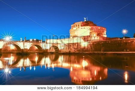 Saint Angel Castle and bridge over the Tiber river in Rome Italy