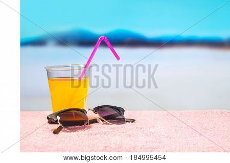 Paradise holiday background with yellow cocktail on sunglasses on beach. Perfect for summer sales and offer campaign promotion. Beautiful holiday paradise vibe with copy space for content and text.