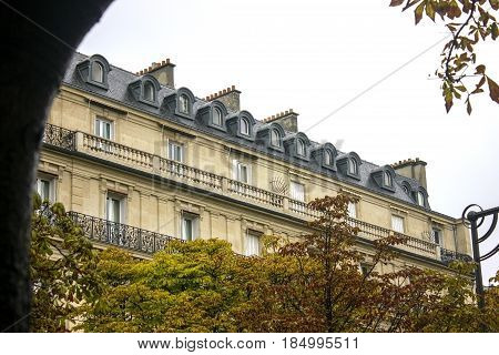 A typical Parisian building with grey roof