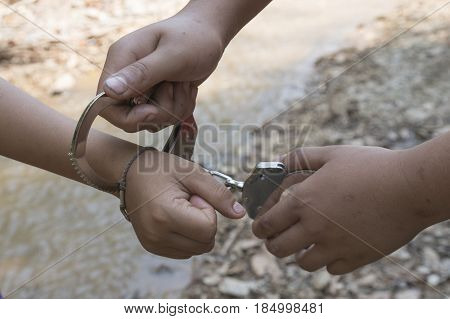 boy hands in handcuffs. no freedom with selective and soft focus.