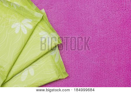 Soft tender protection for woman critical days gynecological menstruation cycle. Menstruation sanitary soft cotton pads for hygiene protection. Pink background with copyspace and place for text