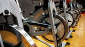Indoor empty stationary bikes for spinning classes poster