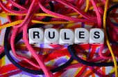 word rules on a  abstract colorful background poster