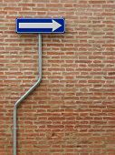 one way sign over a bricks wall - vertical image poster
