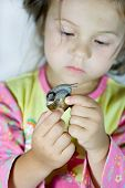 portrait of little girl with the snail poster