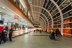 Hong Kong - December 28 2013: Walkway with Travellers in Hong Kong International Airport (Chek Lap Kok Airport)