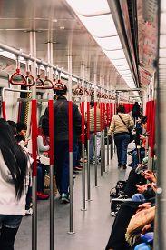 Hong Kong - December 29 2013: Passengers walking in Hong Kong MTR (Mass Transit Railway) Subway Train