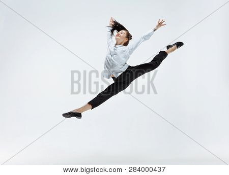 Happy Businesswoman Dancing And Smiling In Motion Isolated On White Studio Background. Flexibility A