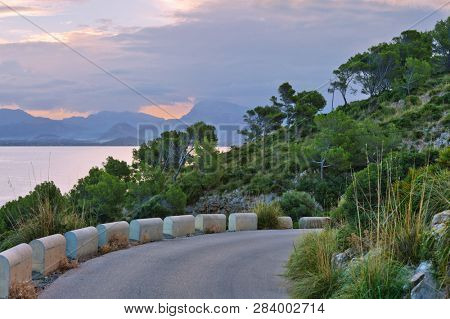 Landscape with sunset at S`illot, Bay of Pollenca near Alcudia. Mallorca. Balearic islands. Spain