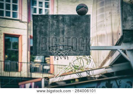 Street Basketball Game. Basketball Shield, Ball Flies To The Basket. Accurate Throw In Basketball Ri