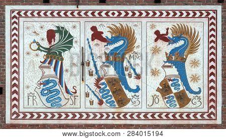 MILAN, ITALY - JUNE 22, 2018: Coat of arms of the Visconti family. Sforza Castle XV century (Castello Sforzesco), Milan (Milano) Lombardy, Italy
