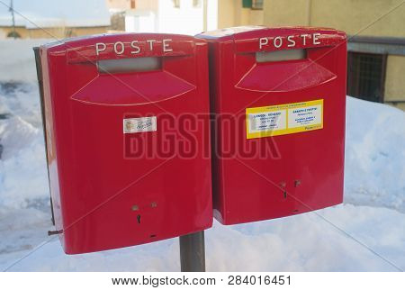 Cortina D Ampezzo, Belluno, Italy - 2 February 2019: Two Red Post Boxes Of The Italian Postal Servic