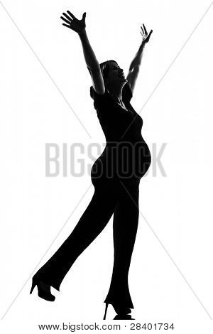 beautiful caucasian pregnant happy woman in full length silhouette on studio isolated white background