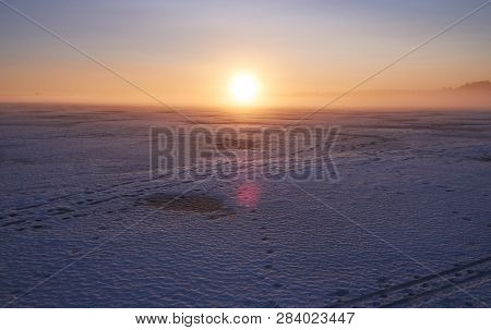 Foggy Winter Day At Icy Lake With Sunset In The Winter In Finland.