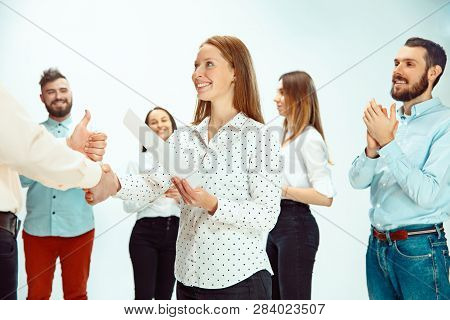 Boss Approving And Congratulating Young Successful Employee Of The Company For Her Successes And Goo
