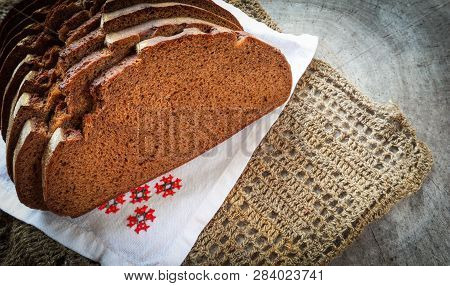 Fresh Rye Sliced Bread, Natural Linen Napkin And White Serviette With Cross-stitch On Rustic Wooden