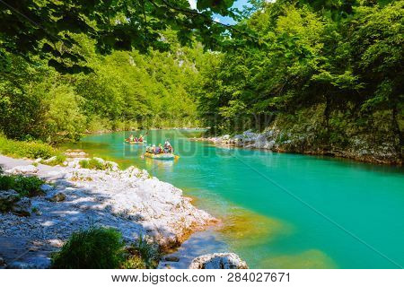 Rafting at mountain river Tara. Location place Durmitor National park, Montenegro, Europe. Scenic image of popular travel destination. Concept of tourist entertainment. Discover the beauty of earth.