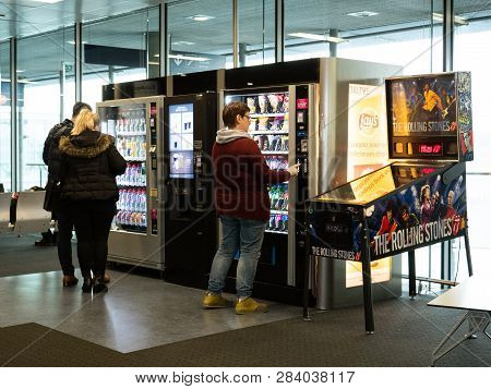 Basel, Switzerland - Nov 11, 2017: People Buying Food And Snacks From The Vending Machines In The Ba