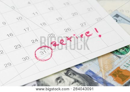 White Clean Calendar With Circle At Date And Handwriting Text As Retire On Us Dollar Banknote Using