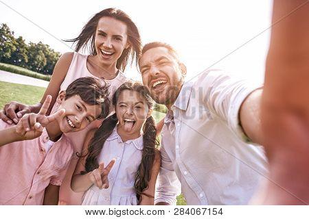 Beautiful Memories. Family Of Four Taking Selfie Photo On Smartp