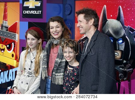 Milla Jovovich and Paul W. S. Anderson at the Los Angeles premiere of 'The Lego Movie 2: The Second Part' held at the Regency Village Theatre in Westwood, USA on February 2, 2019.