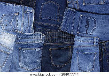 Set Of Different Blue Jeans Top View Flat Lay. Detail Of Nice Blue Jeans. Jeans Texture Or Denim Bac