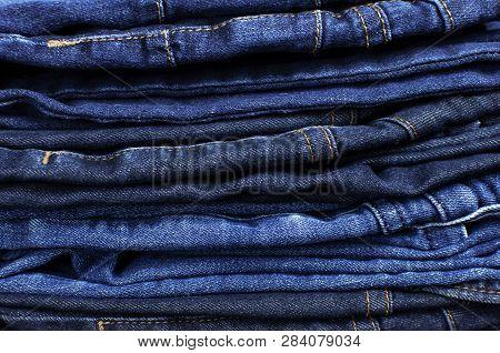 Set Of Different Blue Jeans. Detail Of Nice Blue Jeans. Jeans Texture Or Denim Background. Blue Deni