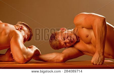 Our Strength Has No Limit. Twins Competitors Arm Wrestling. Men Competitors Try To Win Victory Or Re