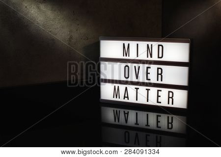 Mind Over Matter Motivational Message On A Light Box In A Cinematic Moody Background