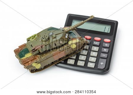 Calculator and toy panzer isolated on white background