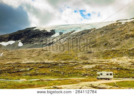 Camper Car In Norwegian Mountains. Camping On Nature. Traveling, Holidays And Adventure Concept.