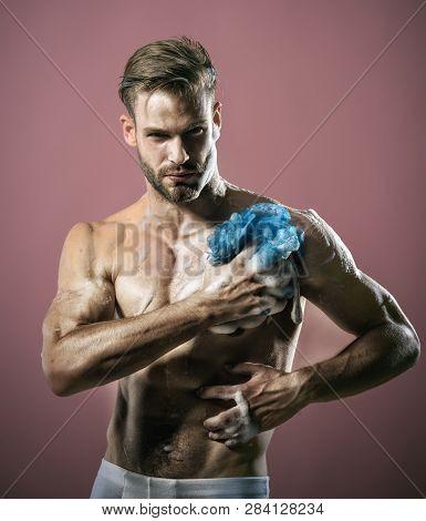 Man Washing Torso In Bathroom. Handsome Sexy Man Washing Body With Sponge. Skin Care, Spa, Beauty Co