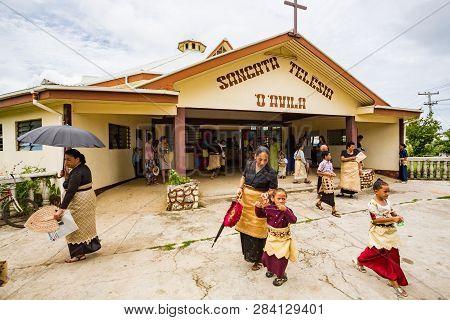Haapai, Tonga - 5 Jan 2014: Polynesian Parishioners In Traditional Tongan Dress Walk Out Of Church A