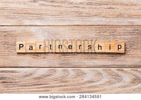 Partnership Word Written On Wood Block. Partnership Text On Wooden Table For Your Desing, Concept