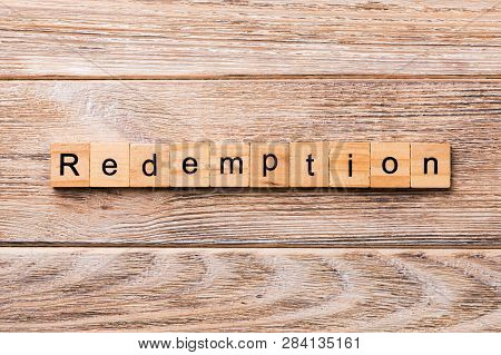 Redemption Word Written On Wood Block. Redemption Text On Wooden Table For Your Desing, Concept