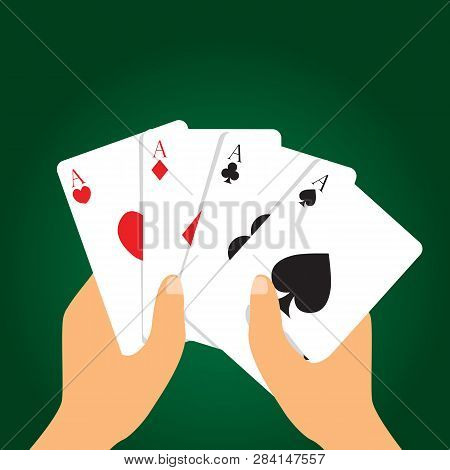 Hand Holding Playing Cards On Green Background. Hand Holding Four Aces. Poker Playing Card Concept.